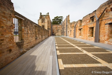 The paving marks the walls of the old cells.